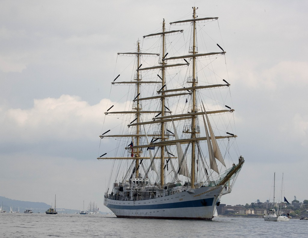 Tall ship with sails down in port