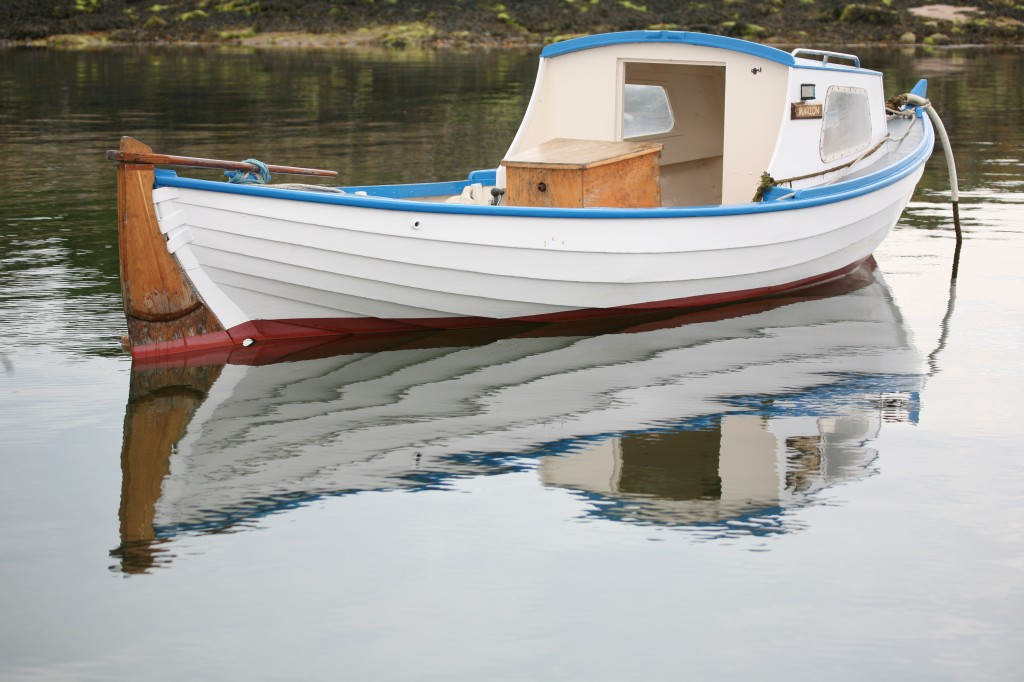 White boat reflected on water surface